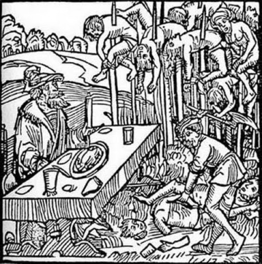 A woodcut depicting Vlad Tepes eating dinner among his impaled victims. History reveals that he actually preferred to impale with a blunted stake, inserted rectally, so his victims would take days to die.