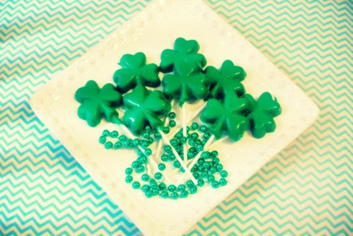 It's easy to make these by melting green candy melts and using shamrock candy molding trays.
