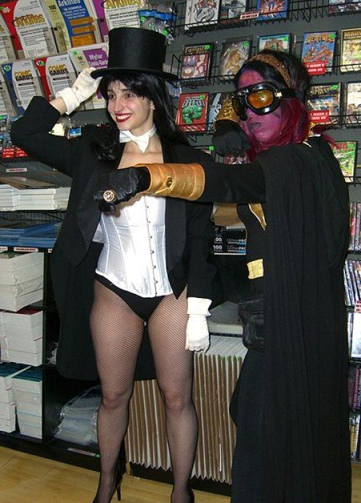 "Two female fans dressed as comic book characters Zatanna and a member of the Sinestro Corps at the August 31, 2011 midnight signing of Flashpoint #5 and Justice League #1 by creators Jim Lee and Geoff Johns, as part of ""The New 52"","