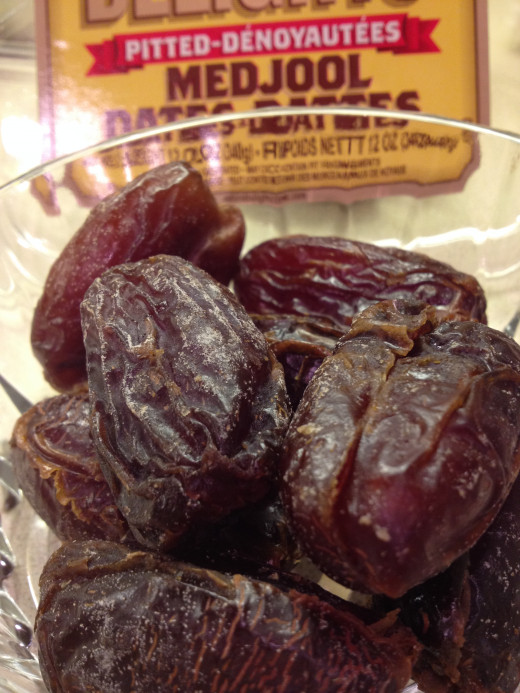 Dates are a natural sweetener.  Chop them in half before processing.  This will make the blending easier.