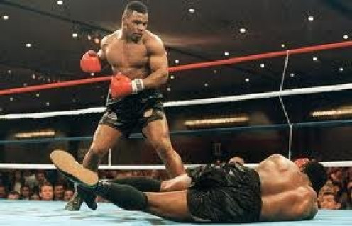 Mike Tyson knocked out Trevor Berbick to win the heavyweight crown and become the youngest heavyweight champion in history at age twenty.