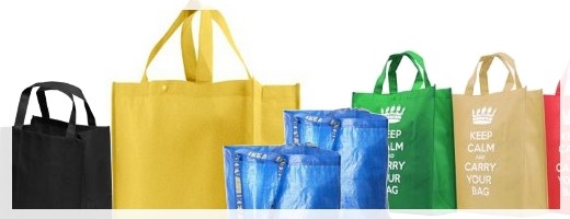 Plenty of shopping bags available to buy before you go to a store, or pay 10 to 27 cents per plastic bag at the register, or carry out your items un-bagged.