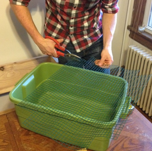 Cut the wire mesh to the size of your self-watering container.