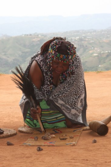 A Sangoma women in the process of a reading.