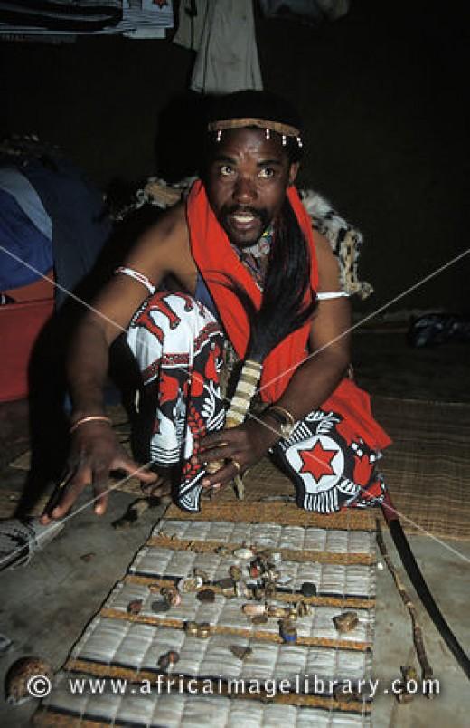A Sangoma man reading thrown bones.