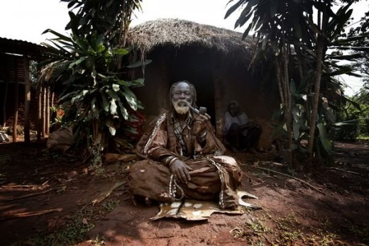 A well respected Sangoma in front of his Ndumba.
