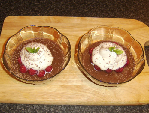 Mint sprigs provide the final garnish for the raspberry, cream and coffee ginger jelly dessert