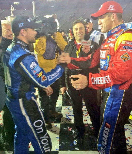 Teammate Stenhouse (left) congratulates Edwards in victory lane