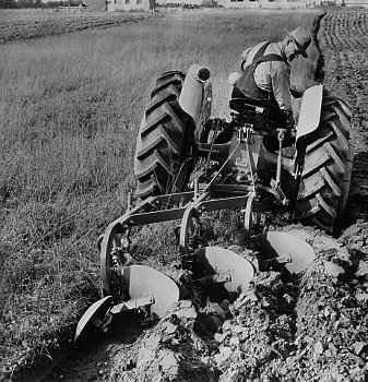 At age nine, I didn't have a camera to capture my dad on Mrs. Dobbs' Ford Tractor. This one was as close as I could find
