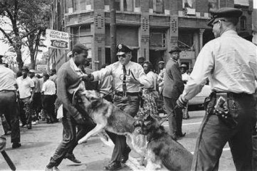 The famous picture here is from a peaceful 1963 Civil Right march in which the police attacked the people very violently. It appeared on the front page of the NY Times and so shocked the country it became an issue at the White House.