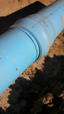 C900 pipe has a leak that was uncovered using helium leak detection.