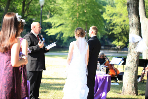 Saying our vows at our picnic wedding.