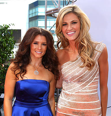 Sprint Cup racecar driver, Danica Patrick, (left) and Erin Andrews enjoy some girl talk during a recent photo shoot