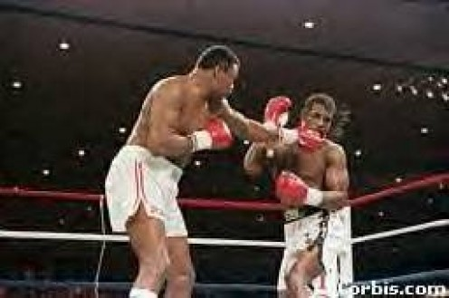 Larry Holmes, seen here popping the jab on Michael Spinks, has one of the best sticks in boxing history.