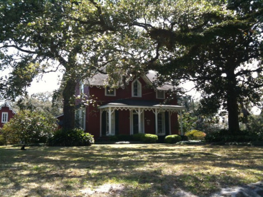 Gothic home from the mid 1800s in gorgeous setting among azaleas, camellias, and live oaks.