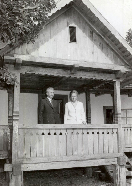 Nicolae Ceausescu and his wife Elena, standing on the porch of Ceausescu's childhood home in Scornicesti, Romania.
