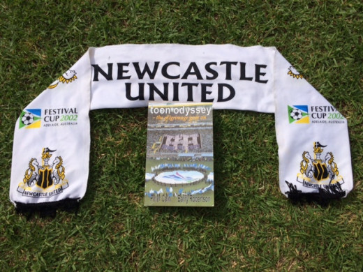 Book surrounded by the Festival City Cup Scarf from 2002...NUFC sent their juniors over to compete!