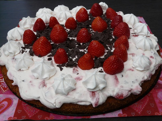 "Strawberries and chocolate chunks say ""I love you"" on this easy but lovely cake."