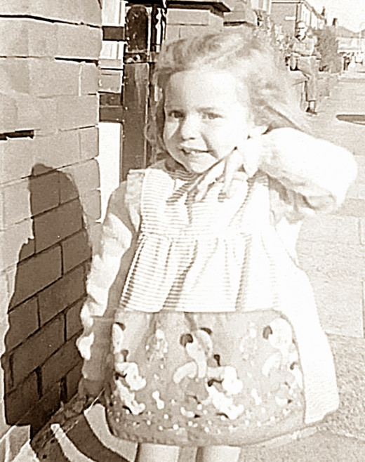 This was me, posing, aged about 18 months, in the street outside grandma's guesthouse. If you look closely, you will see my brother sitting on a wall in the background, keeping an eye on me. Wherever he went, I wasn't far behind.