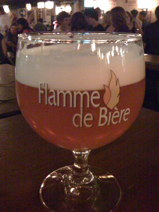 Try the flamed apple beer at Delirium bar, a popular drinking hole that feels like a cool dungeon.