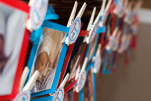 A clothespin display is perfect for sharing photos of the birthday twins. This individual shared 12 photos of each twin with one each from the first 12 months of their lives.