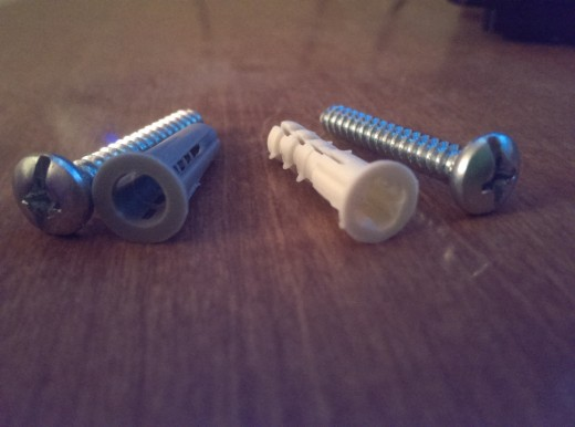 These are two examples of drywall anchors. The grey piece and the white piece are the anchors.
