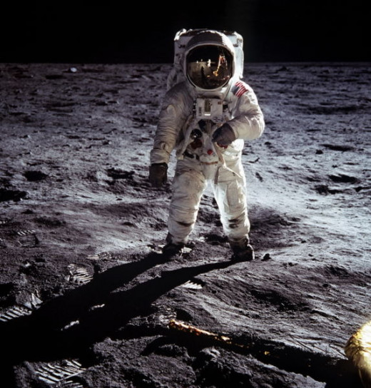 "Astronaut Buzz Aldrin, lunar module pilot, walks on the surface of the Moon near the leg of the Lunar Module (LM) ""Eagle"" during the Apollo 11 extravehicular activity (EVA). Astronaut Neil A. Armstrong, commander, took this photograph"
