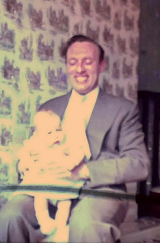 My dad, Richard Evans, pictured with me when I was only a few weeks old.