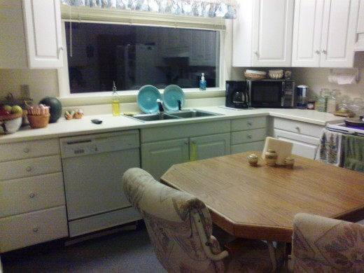 This kitchen was cut off from the family and dining areas and had a lot of wasted space. The laminate counters were so old the finish was wearing off from repeated scrubbing, and the color of the room was lack-luster