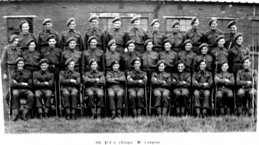 Dad in the Army in the days of National Service. He is on the centre row, fourth from the left.