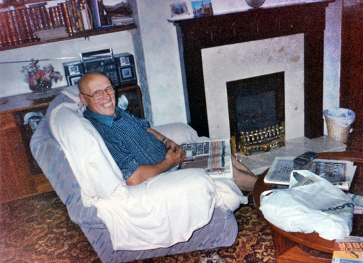 Dad sitting in the dining room in the 1990s - behind him were the book shelves and cabinet that he had made at joinery classes many years earlier. In front of him is the coffee table which he also made.
