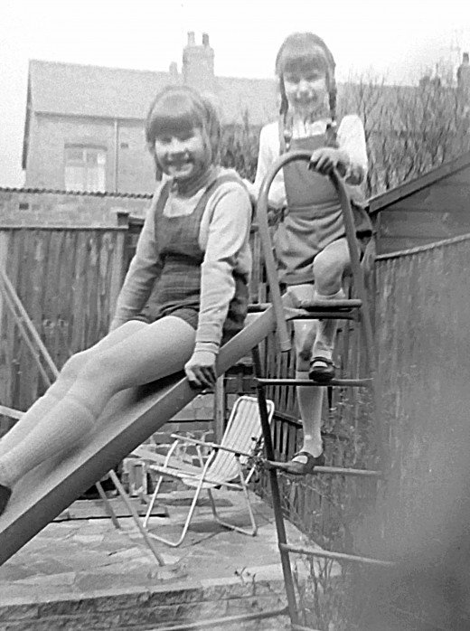 Me and my friend, Valerie, who lived up our street, in the back garden in the 1970s, playing on the slide that dad had made.