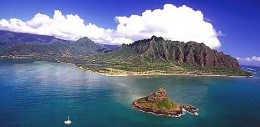 Beautiful aerial shot of Chinaman's Hat in foreground, Kualoa Park, Kualoa Ranch & Ko'olau Mountains.