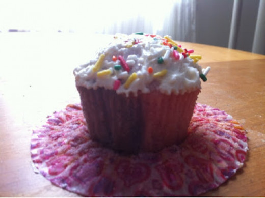 Pink/Purple Cupcake made by pouring the two batters at the same time.