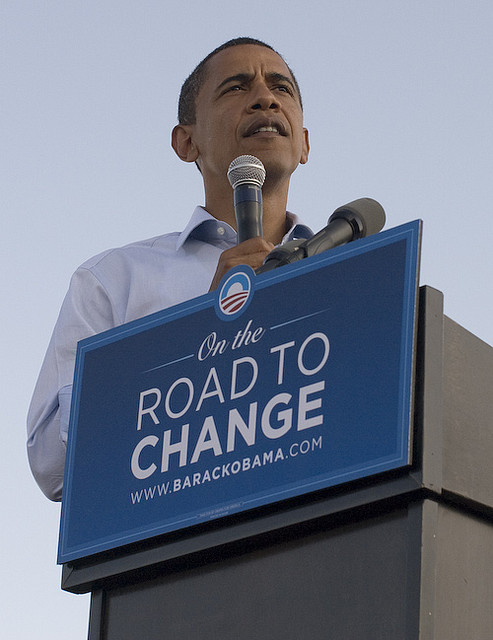 "Barack Obama standing behind ""Road to Change"" podium"