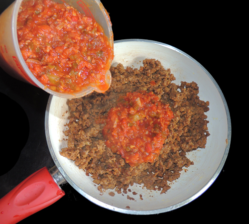 Heat crumbles in a little oil in another pan, and then add the Sloppy Joe mix to that.
