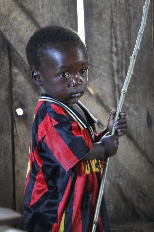 A child from the Congo with a stick