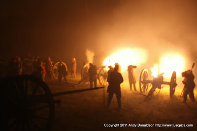 Living Historians fire cannon at night
