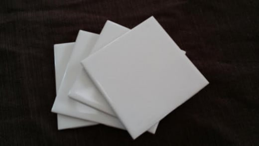 Plain white ceramic tiles are a bargain for this DIY photo coaster project