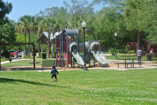 Parks offer space to play and run free.  You don't have to come up with many games or activities to keep kids entertained.  Many have grills, picnic shelters and tables you can use for free or pay a small rental fee.