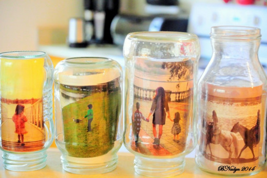 Reuse glass jars to hold photos for added decoration by placing the birthday girl or boy's pictures in the jars.
