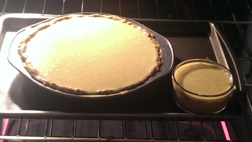 here it is baking - I had a little extra so I made a mini pie in a pyrex dish!