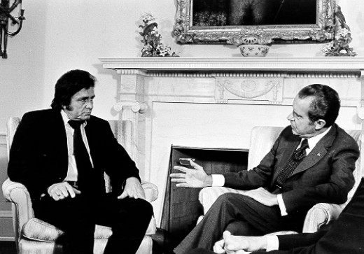 Johnny Cash discusses prison reform with Richard Nixon at the White House.