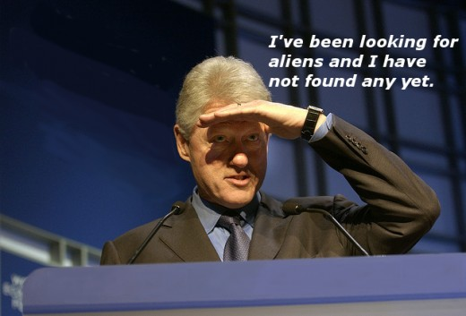 Bill Clinton peering out into a crowd of humanoids.
