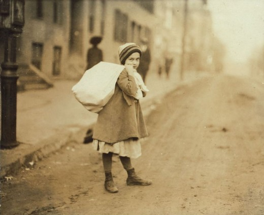 young girl carrying a sack of tesserae in exchange for her name to be entered into The Hunger Games