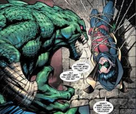 Killer Croc battles Robin.