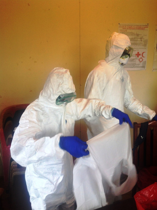 Trained volunteers outfitted with protective equipment and mobilized to disinfect houses, help remove dead bodies, and help reduce fear among communities