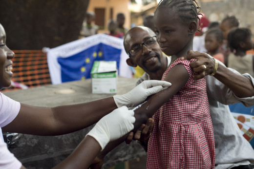 A young Guinean girl gets her measles vaccination, as part of the joined collaborative effort of the Ministry of Health, Doctors Without Borders &  the European Community Humanitarian Office to vaccinate the country's children against the disease.