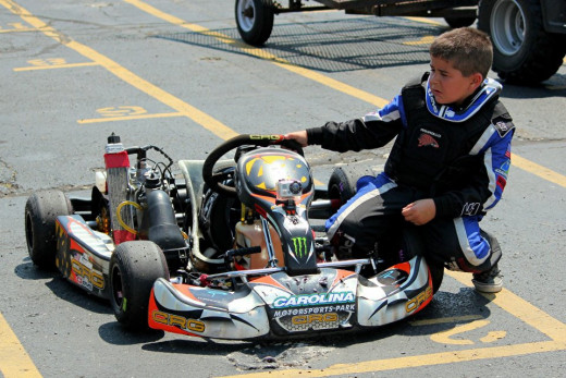 A young karter getting ready to race in a kids kart race