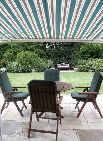 Keep your guests and family in the shade with a patio cover.
